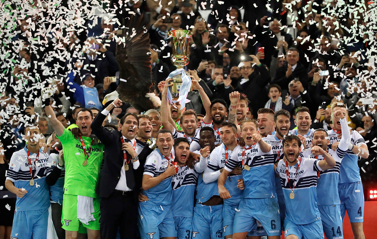 Lazio's Senad Lulic holds up the Italian Cup trophy at the end of the final match between Lazio and Atalanta, at the Rome Olympic stadium, Wednesday, May 15, 2019. (AP Photo/Alessandra Tarantino)