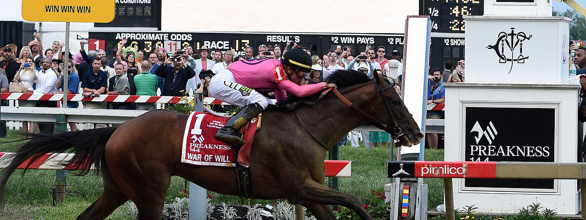 War of Will, ridden by Tyler Gaffalione, crosses the finish line first to win the Preakness  at Pimlico Race Course, Saturday, May 18, 2019, in Baltimore. (AP Photo/Mike Stewart)