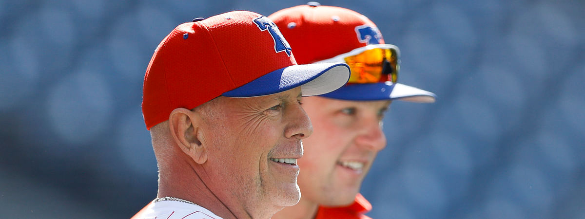 The highlight of Rhys Hoskins' last weeks was a May 15 pregame meeting with actor Bruce Willis (left), who has as many extra-base hits since May 8 as Hoskins does (Matt Slocum)