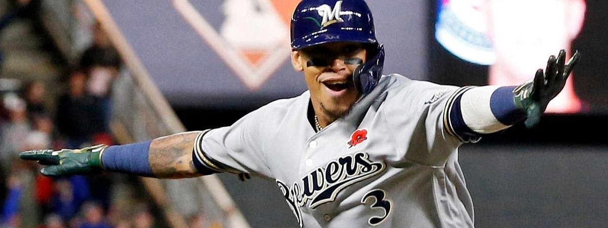 Milwaukee Brewers' Orlando Arcia celebrates as he rounds third base on his two-run home run off Minnesota Twins pitcher Taylor Rogers in the eighth inning of a baseball game on May 27, 2019.