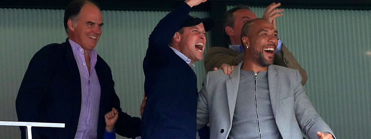 Britain's Prince William, second left, and former footballer John Carew, right, celebrate after Aston Villa's Anwar El Ghazi scores his side's first goal of the game during the English Championship Play-off soccer final between Aston Villa and Derby County at Wembley Stadium, London, Monday, May 27, 2019. (Mike Egerton/PA via AP)