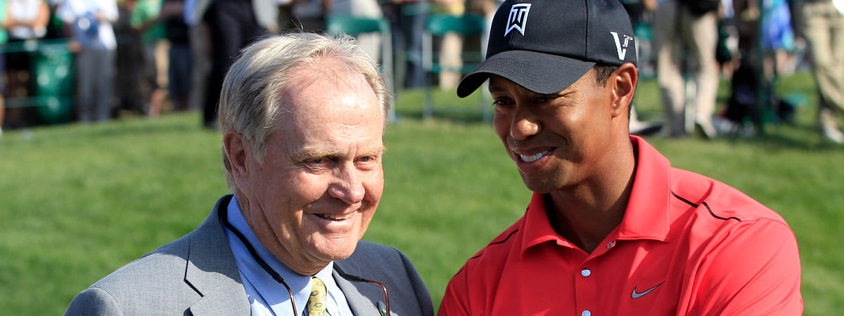 FILE - In this June 3, 2012, file photo, Jack Nicklaus, left, talks with Tiger Woods after Woods won the Memorial golf tournament at the Muirfield Village Golf Club in Dublin, Ohio. Winning his 15th major has renewed the conversation of whether he can catch the record held by Nicklaus. (AP Photo/Tony Dejak, File)