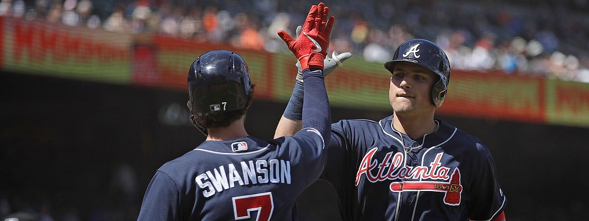 Braves' Austin Riley (right) celebrates his eighth-inning home run with teammate Dansby Swanson on May 23 (Ben Margot)