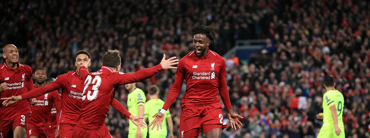 Liverpool's Divock Origi, center, celebrates scoring his side's fourth goal of the game during the Champions League Semi Final, second leg soccer match between Liverpool and Barcelona on Tuesday, May 7, 2019.
