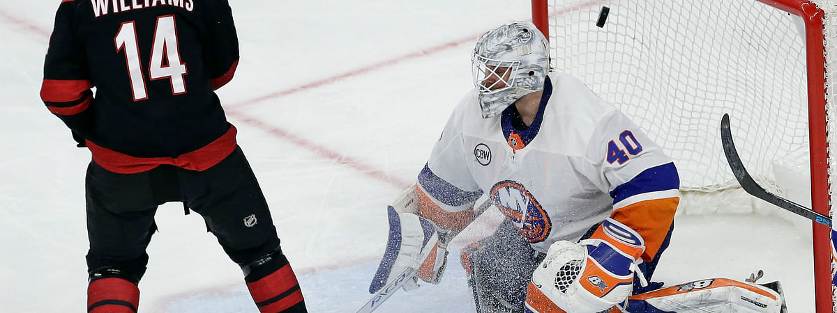 Carolina Hurricanes' Justin Williams  scores the game-winning goal against New York Islanders goalie Robin Lehner, of Sweden, during Game 3 of the NHL hockey second-round playoff series on May 1, 2019.