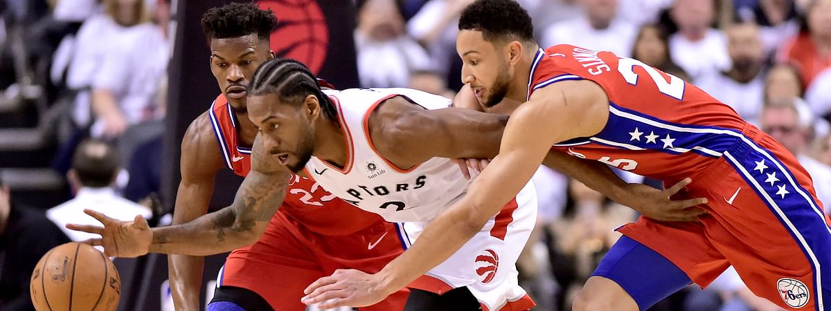 Sixers guard Jimmy Butler (23) and teammate Ben Simmons pressure Toronto  forward Kawhi Leonard in Game 7 on May 12 (Frank Gunn/The Canadian Press)