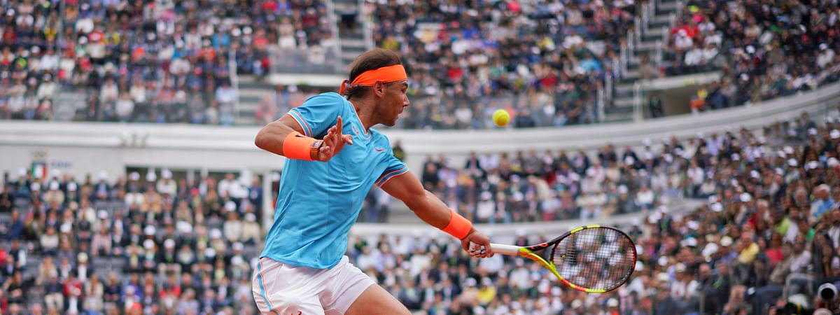 Rafael Nadal of Spain returns the ball to Stefanos Tsitsipas of Greece during a semifinal match at the Italian Open tennis tournament, in Rome, Saturday, May 18, 2019. (AP Photo/Andrew Medichini)