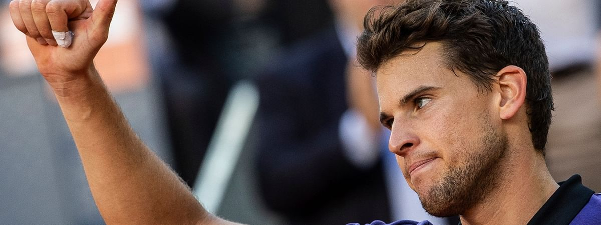 Dominic Thiem celebrates after beating Roger Federer at the Madrid Open tennis tournament, Friday, May 10, 2019. (AP Photo/Bernat Armangue)