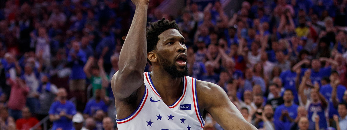 Philadelphia 76ers' Joel Embiid reacts to his dunk in  Game 3 of the  NBA playoff series against the Toronto Raptors, Thursday, May 2, 2019, in Philadelphia. The 76ers won 116-95. (AP Photo/Chris Szagola)