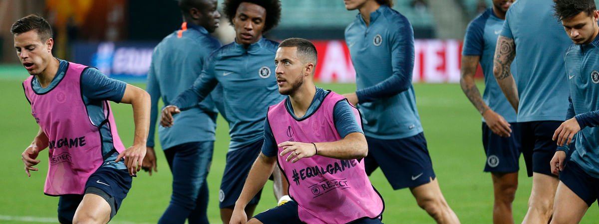 Chelsea's Eden Hazard, center, stretches during a soccer training session at the Olympic stadium in Baku, Azerbaijan on May 28, 2019. English Premier League teams Arsenal and Chelsea are preparing for the Europa League Final soccer match that takes place in Baku on Wednesday night.