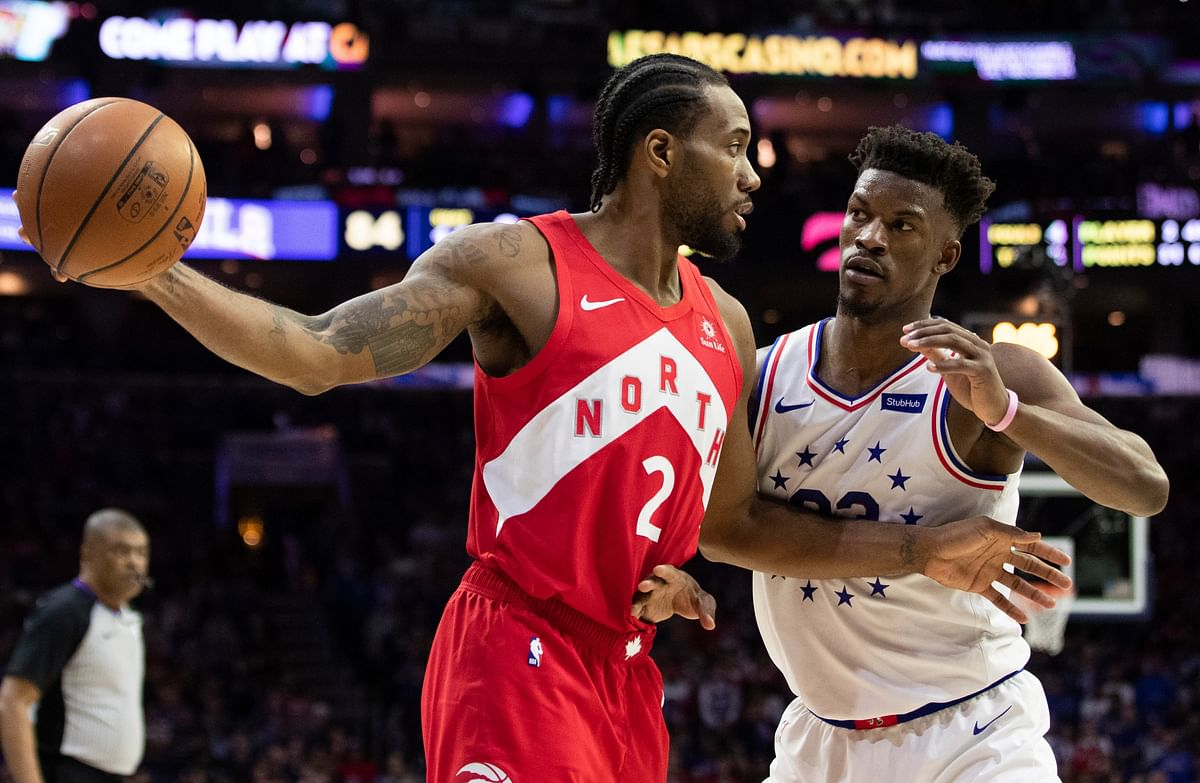 Toronto Raptors' Kawhi Leonard, left, holds the ball away from Philadelphia 76ers' Jimmy Butler, right, during the second half of Game 4 of a second-round NBA basketball playoff series, Sunday, May 5, 2019, in Philadelphia. The Raptors won 101-96. (AP Photo/Chris Szagola)