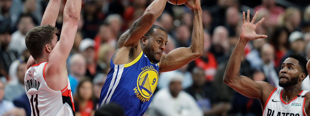 Golden State Warriors guard Andre Iguodala, center, is defended by Portland Trail Blazers forwards Meyers Leonard, left, and Maurice Harkless during the first half of Game 3 of the NBA basketball playoffs Western Conference finals Saturday, May 18, 2019, in Portland, Ore. (AP Photo/Ted S. Warren)