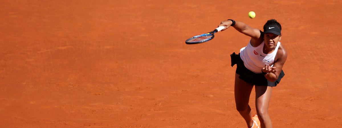 Japan's Naomi Osaka returns the ball during her match against Slovakia's Dominika Cibulkova during the Madrid Open tennis tournament, Sunday, May 5, 2019, in Madrid, Spain. (AP Photo/Andrea Comas)