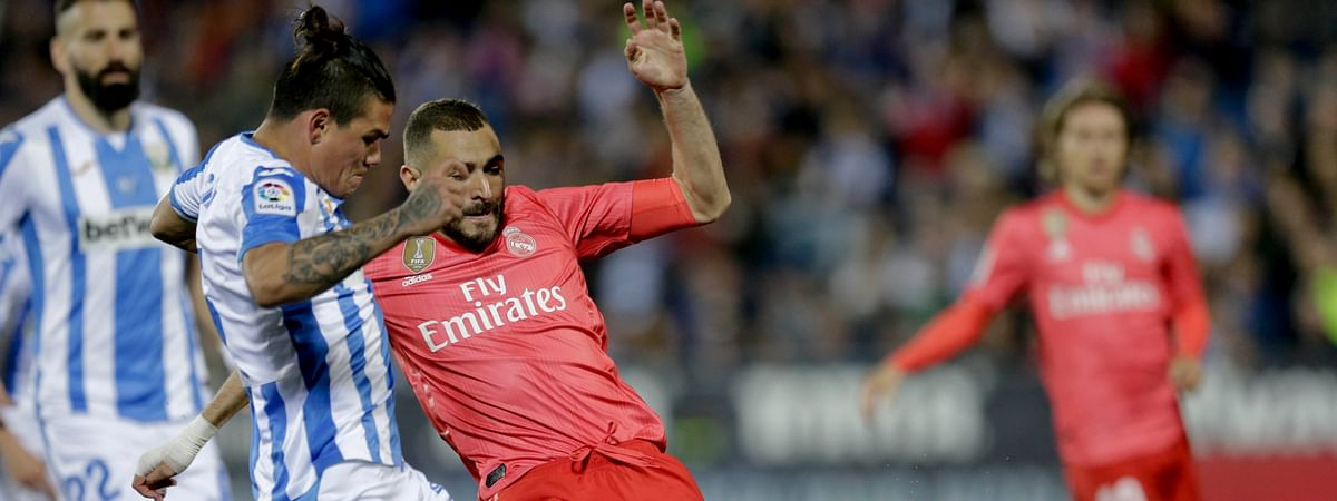 Real Madrid's Karim Benzema duels for the ball against Leganes' Jonathan Cristian, left, Silva during a Spanish La Liga soccer match on April 15, 2019.
