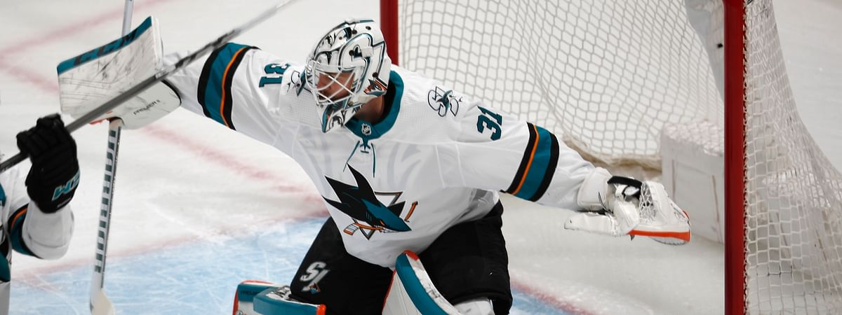 San Jose Sharks goaltender Martin Jones deflects a shot in the first period of Game 6 of an NHL hockey second-round playoff series against the Colorado Avalanche on May 6, 2019.