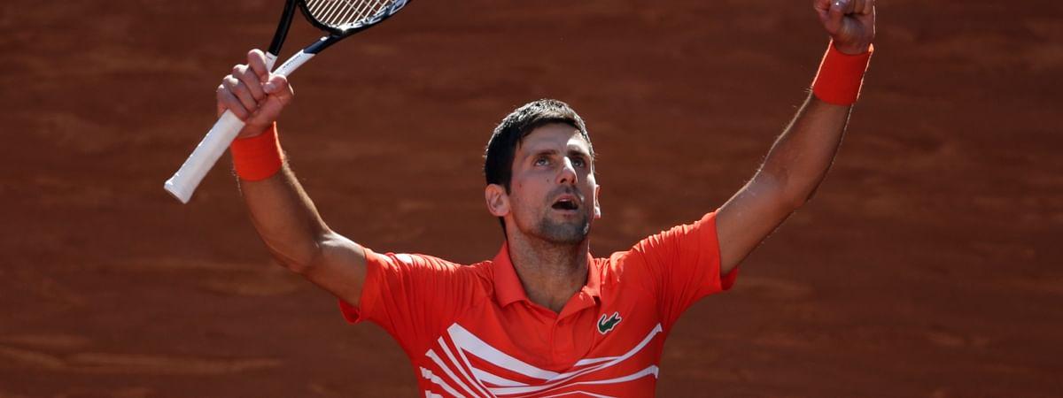 Novak Djokovic celebrates after beating Dominic Thiem in the Madrid Open semis, Saturday, May 11, 2019. (AP Photo/Bernat Armangue)