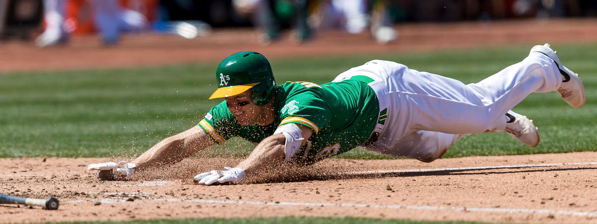 Athletics' Nick Hundley scores on a triple and error in fifth inning May 11 (John Hefti)