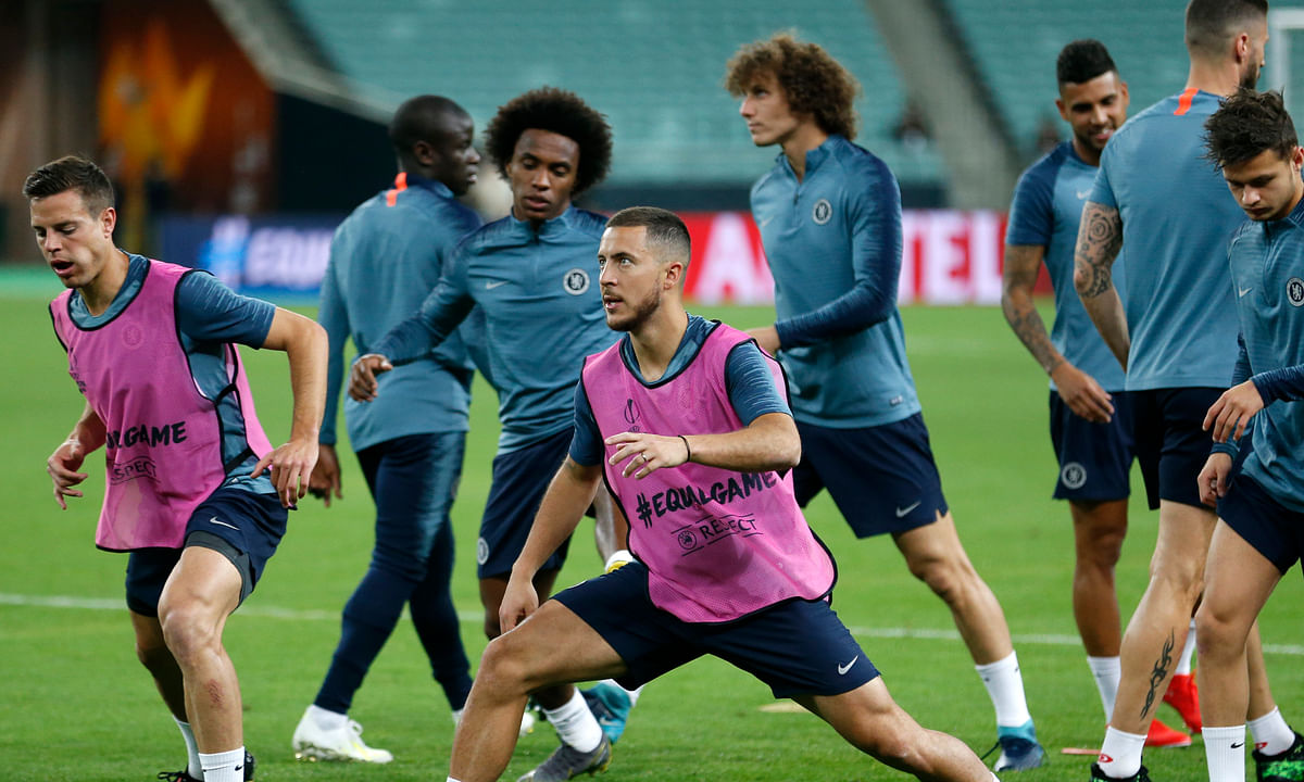 Chelsea's Eden Hazard, center, stretches during a soccer training session at the Olympic stadium in Baku, Azerbaijan, Tuesday May 28, 2019. English Premier League teams Arsenal and Chelsea are preparing for the Europa League Final soccer match that takes place in Baku on Wednesday night. (AP Photo/Darko Bandic)