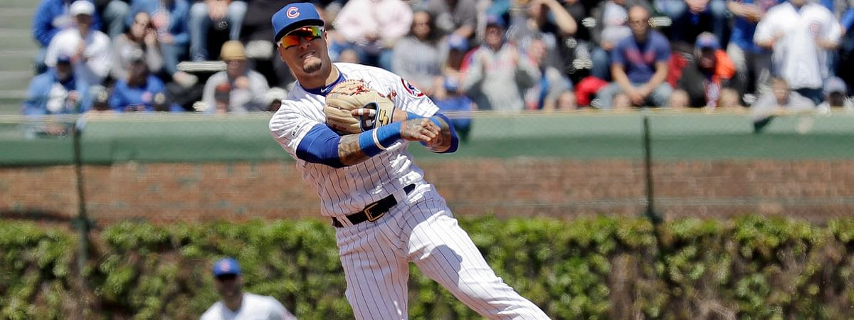 Cubs' shortstop Javier Baez makes a play in a game on May 10 against the Brewers at Wrigley Field (Nam Y. Huh)