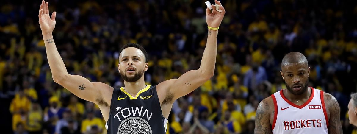 Golden State Warriors' Stephen Curry, left, celebrates next to Houston Rockets' PJ Tucker during the second half of Game 2 of a second-round NBA basketball playoff series in Oakland, Calif., Tuesday, April 30, 2019. (AP Photo/Jeff Chiu)