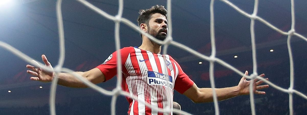 FILE - In this Wednesday, Feb. 20, 2019 file photo, Atletico forward Diego Costa reacts after missing a goal. (AP Photo/Manu Fernandez, File)
