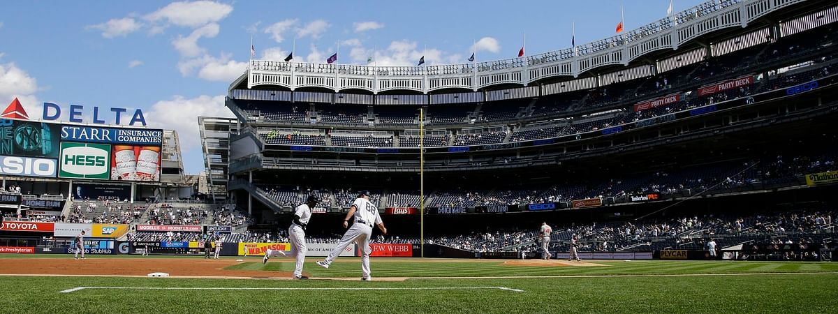 Yankees' Cameron Maybin rounds the bases after homering in the opening game of a May 15 doubleheader  (Frank Franklin II)