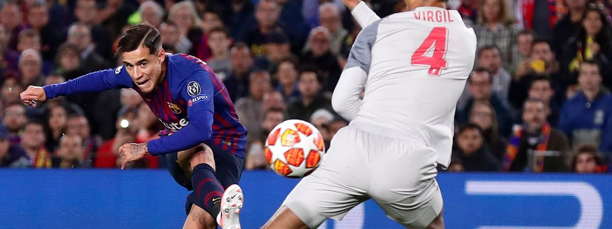 Barcelona's Philippe Coutinho, left, shoots on goal as Liverpool's Virgil Van Dijk tries to block the shot during the Champions League semifinal first leg soccer match between FC Barcelona and Liverpool on May 1, 2019.
