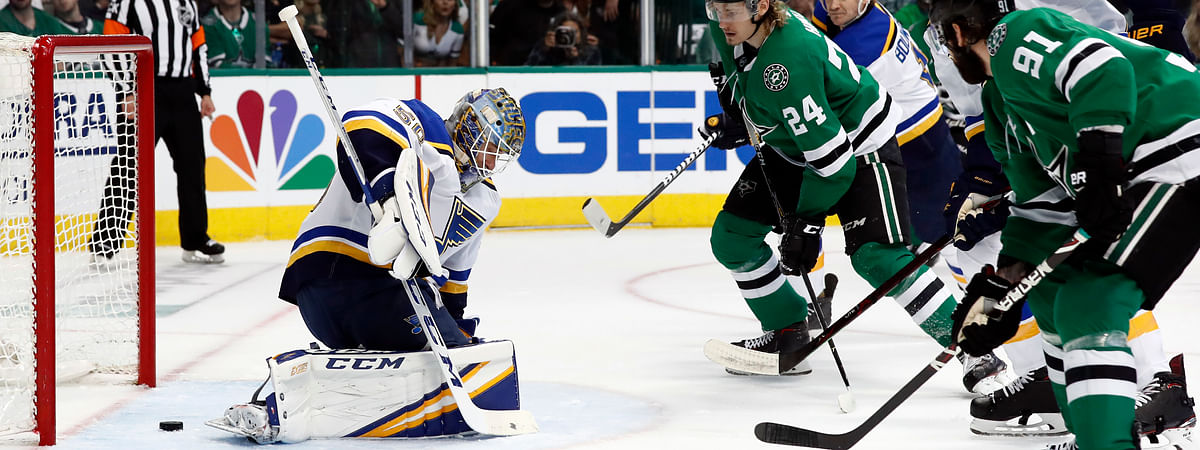 Dallas Stars' Tyler Seguin (91) scores past St. Louis Blues goaltender Jordan Binnington (50) as Stars' Roope Hintz (24) watches during the first period of Game 6 on May 5, 2019.