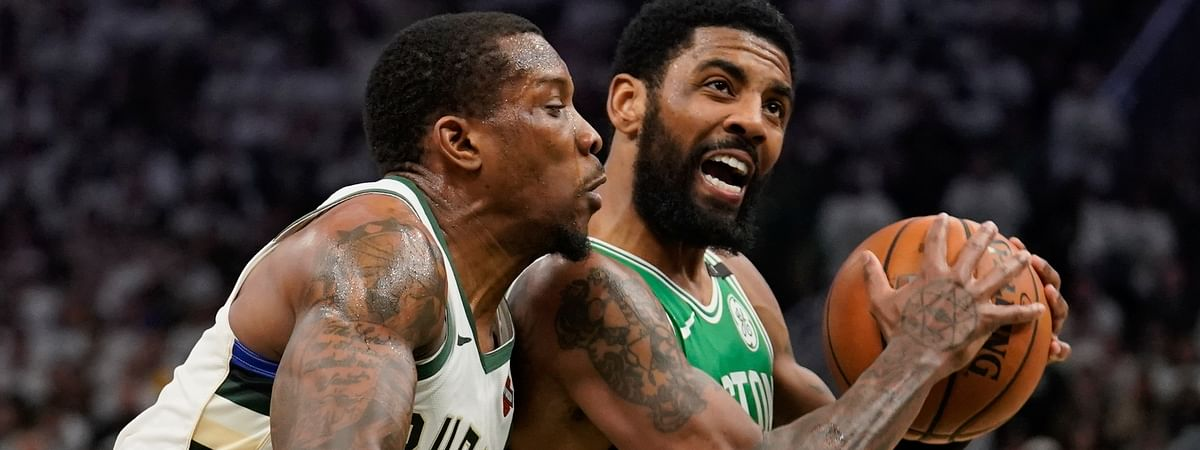 Boston Celtics' Kyrie Irving tries to drive past Milwaukee Bucks' Eric Bledsoe during the second half of Game 2 of the second round NBA basketball playoff series on April 30, 2019.