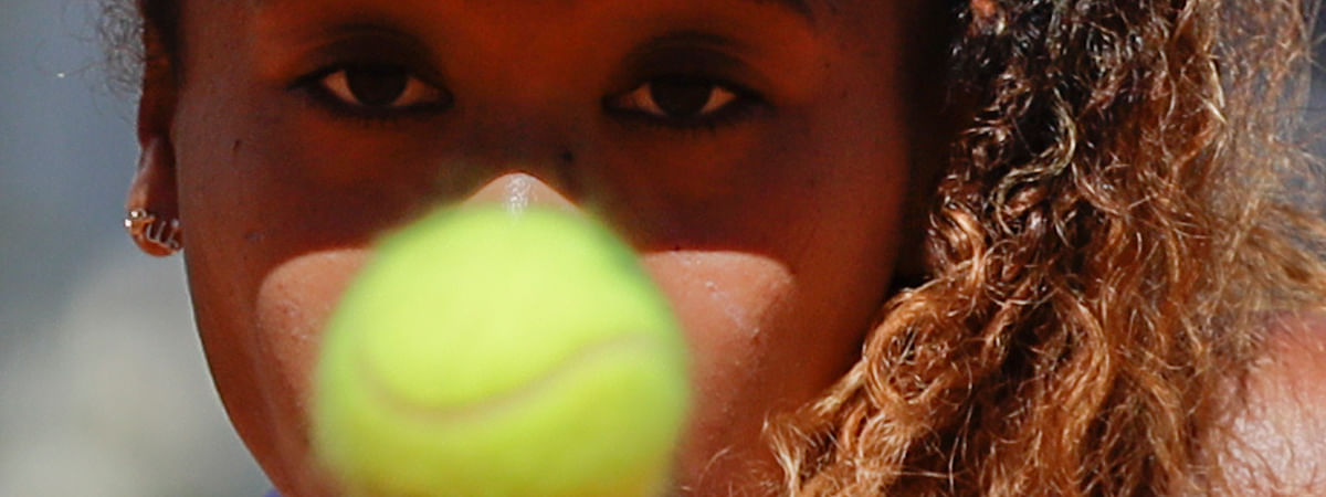 Japan's Naomi Osaka eyes the ball during her match against Slovakia's Dominika Cibulkova at the Italian Open tennis tournament, in Rome, Thursday, May, 16, 2019. (AP Photo/Gregorio Borgia)