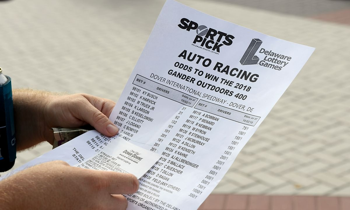 FILE - In this Oct. 7, 2018, file photo, an odds sheet and betting slip are seen at Dover International Speedway before the NASCAR Cup series auto race at Dover International Speedway in Dover, Del. NASCAR is making its first big play in the world of expanded legal sports betting, officials announced Friday, May 3, 2019. (AP Photo/Nick Wass, File)