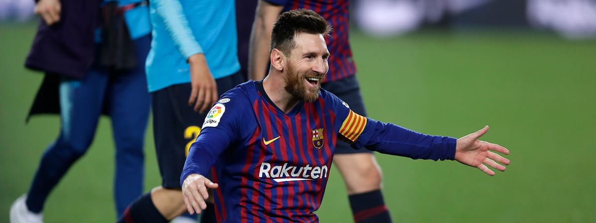 Barcelona forward Lionel Messi celebrates winning the Spanish League title, at the end of the Spanish La Liga soccer match between FC Barcelona and Levante on April 27, 2019.