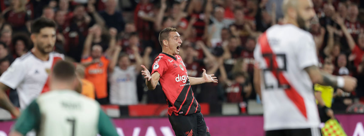 Marco Ruben of Brazil's Athletico Paranaense, center, celebrates after scoring against Argentina's River Plate during Recopa Sudamericana first leg final soccer match in Curitiba, Brazil, Wednesday, May 22, 2019. (AP Photo/Andre Penner)