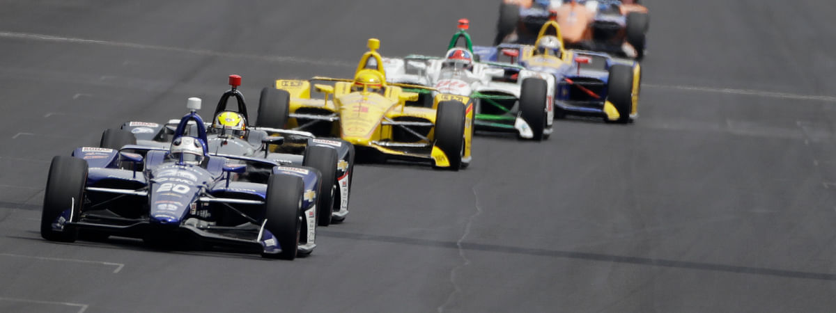 Ed Carpenter leads a group of cars into turn one during the May 24 final practice session for the Indianapolis 500 (Darron Cummings)