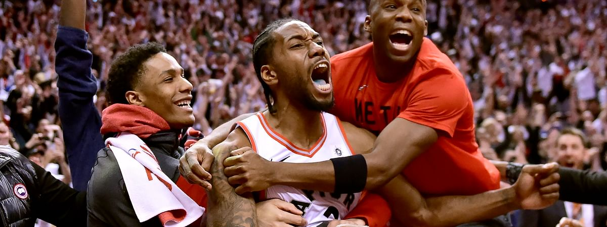 Toronto Raptors forward Kawhi Leonard celebrates his last-second basket with teammates at the end of the second half of an NBA Eastern Conference semifinal basketball game against the Philadelphia 76ers in Toronto on May 12, 2019.