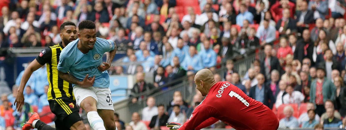 Manchester City's Gabriel Jesus, center, scores his side's fourth goal during the English FA Cup Final soccer match between Manchester City and Watford at Wembley stadium in London, Saturday, May 18, 2019. (AP Photo/Tim Ireland)