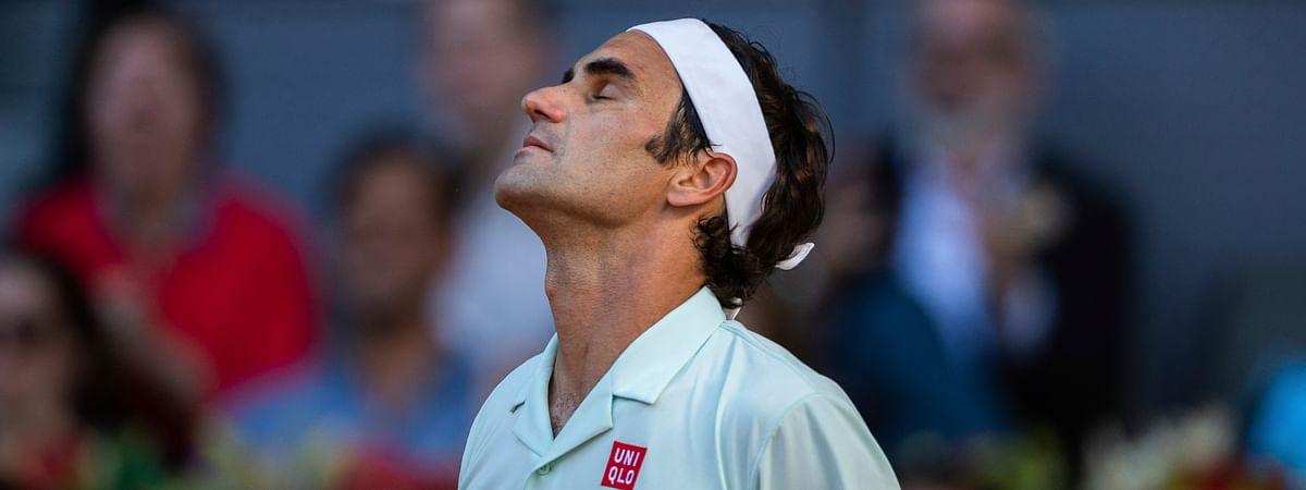 Roger Federer, from Switzerland, reacts after losing a point during the Madrid Open tennis match against Dominic Thiem, from Austria, in Madrid, Spain, Friday, May 10, 2019.