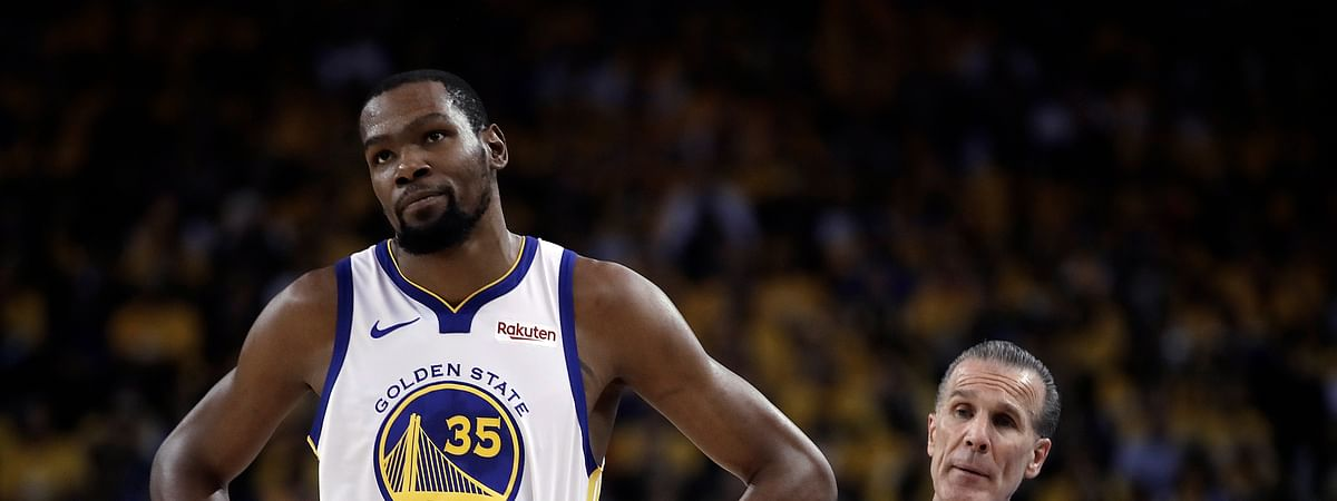 Golden State Warriors' Kevin Durant, left, is out for the rest of the series against the Houston Rockets. (AP Photo/Ben Margot)