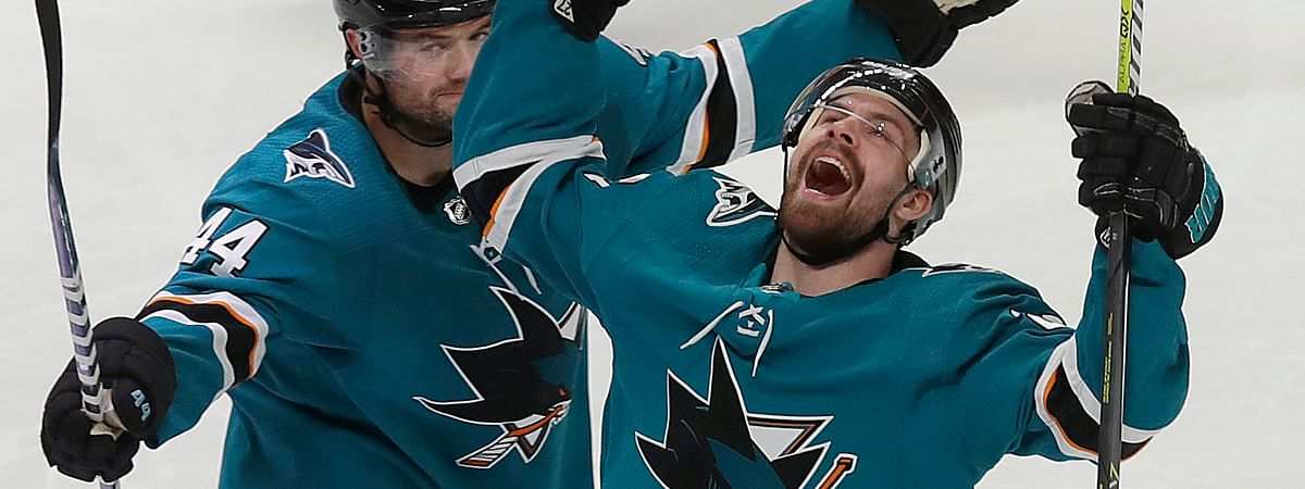 San Jose Sharks right wing Joonas Donskoi, right, celebrates with defenseman Marc-Edouard Vlasic after scoring a goal against the Colorado Avalanche in Game 7 of the NHL hockey second-round playoff series on May 8, 2019.