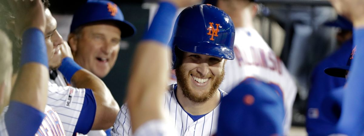 New York Mets starting pitcher Zack Wheeler smiles while celebrating with teammates after hitting a home run  against the Philadelphia Phillies Tuesday, April 23, 2019. (AP Photo/Frank Franklin II)