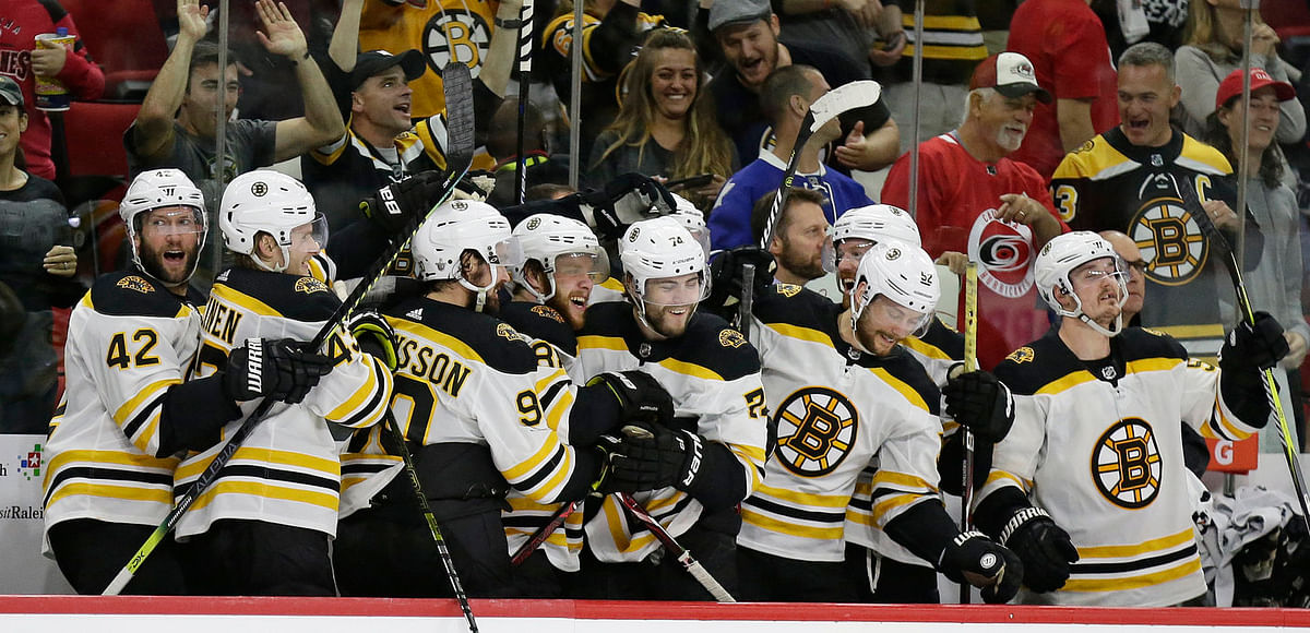 Bruins on the bench celebrate as they advance to the Stanley Cup Finals by beating the Hurricanes (Gerry Broome)