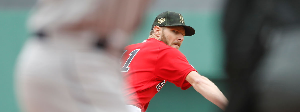 Boston Red Sox starting pitcher Chris Sale delivers against the Houston Astros during the first inning of a baseball game on May 19, 2019, at Fenway Park in Boston.