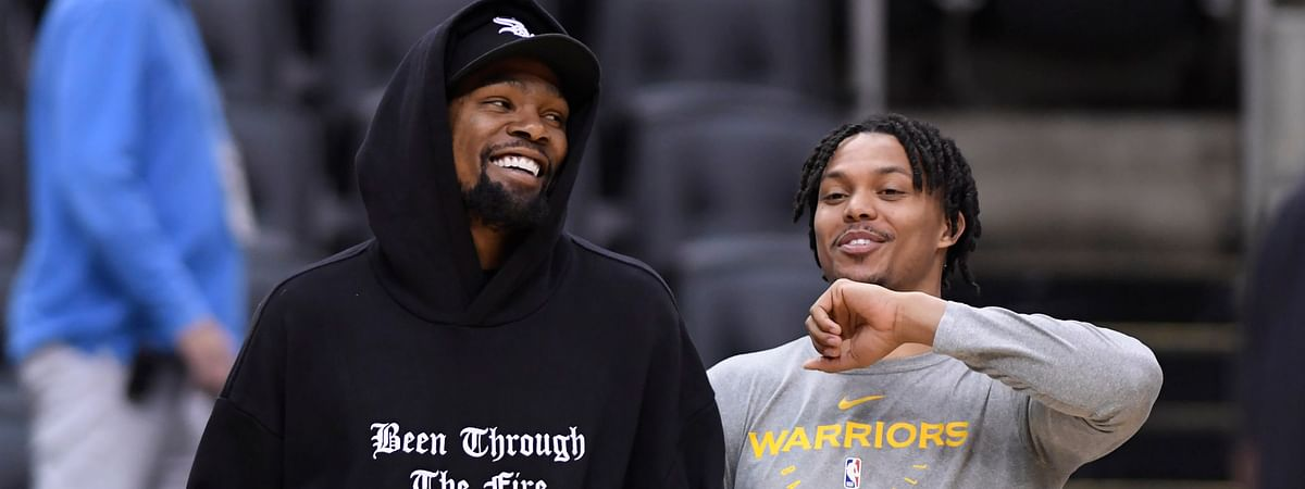 Warriors Kevin Durant (left) laughs with teammate Damion Lee during practice on June 1 (Nathan Denette/The Canadian Press)