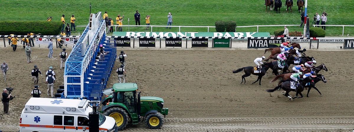 FILE - In this Saturday, June 9, 2018, file photo, horses break from the starting gate for the 150th running of the Belmont Stakes. (AP Photo/Mel Evans, File)