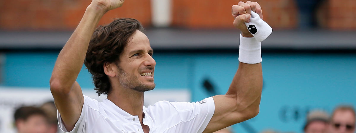 Feliciano Lopez of Spain celebrates after defeating Gilles Simon of France 6-2/6-7/7-6 in their men's singles final match at the Queens Club tennis tournament in London, Sunday, June 23, 2019. (AP Photo/Tim Ireland)