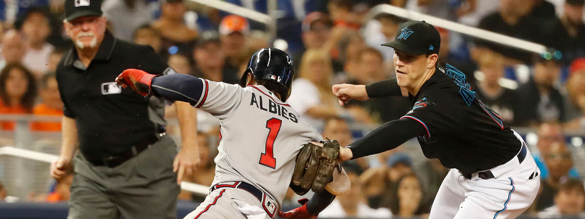 Braves' Ozzie Albies is tagged out at third base by Marlins  Brian Anderson on June 8 (Wilfredo Lee)