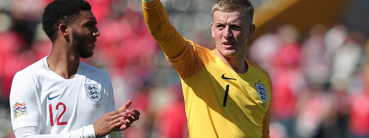 England's Joe Gomez, left, and England goalkeeper Jordan Pickford celebrate after the winning at the end the UEFA Nations League third place soccer match between Switzerland and England at the D. Afonso Henriques stadium in Guimaraes, Portugal, Sunday, June 9, 2019. (AP Photo/Luis Vieira)