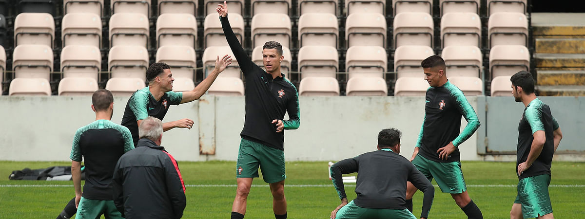 Portugal's Cristiano Ronaldo (center) gestures during a training session  June 4 (Luis Vieira)
