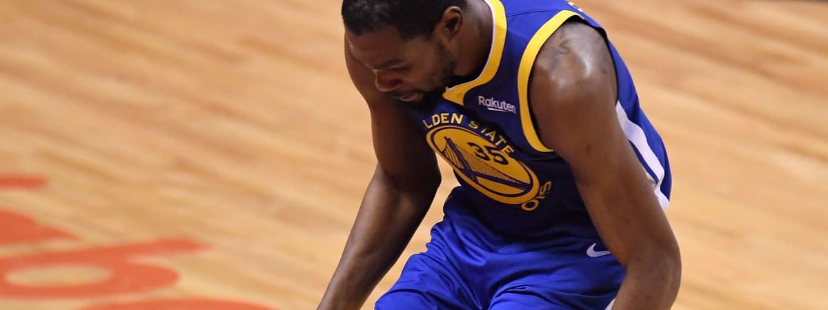 Golden State Warriors forward Kevin Durant (35) hobbles after injuring his right leg during first-half basketball action in Game 5 of the NBA Finals against the Toronto Raptors in Toronto, Monday, June 10, 2019.