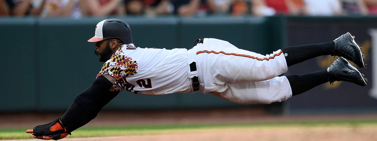 Orioles' Jonathan Villar dives towards third on a single by Trey Mancini during the third inning on June 29 (Nick Wass)
